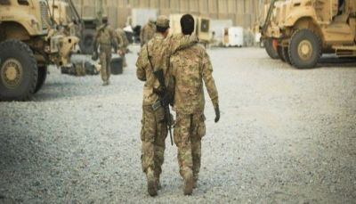 A U.S. soldier from the 3rd Cavalry Regiment walks with the unit's Afghan interpreter before a mission near forward operating base Gamberi in the Laghman province of Afghanistan December 11, 2014. REUTERS/Lucas Jackson/Files