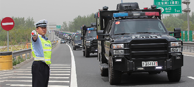 Chinese police drives trucks that officially shouldn't be in China