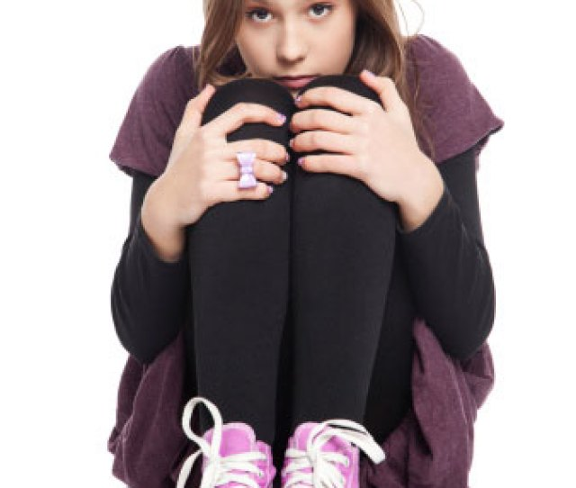 Photo Of A Teenage Girl Sitting By Herself