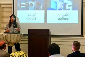 professor Kiju Lee speaks at a podium