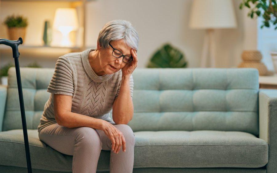 elderly women having a headache
