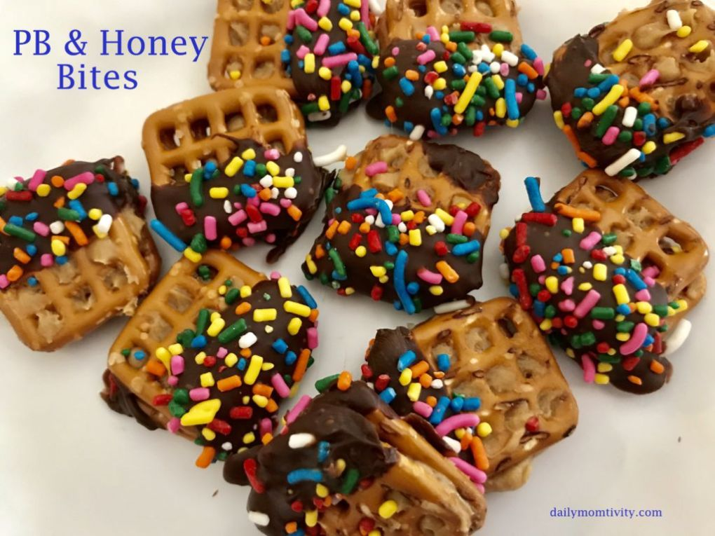 These PB & honey bites are so delicious! PB and honey mixed on a pretzel dipped in chocolate!
