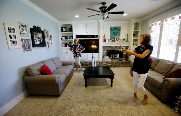 The Room Arranger, Rita Wood of Temecula talks with home owner Kelly Barnson during the living room redesign using pieces already there by rearranging them for a fresh look Monday in Temecula, CA. July 6, 2017. TERRY PIERSON,THE PRESS-ENTERPRISE/SCNG