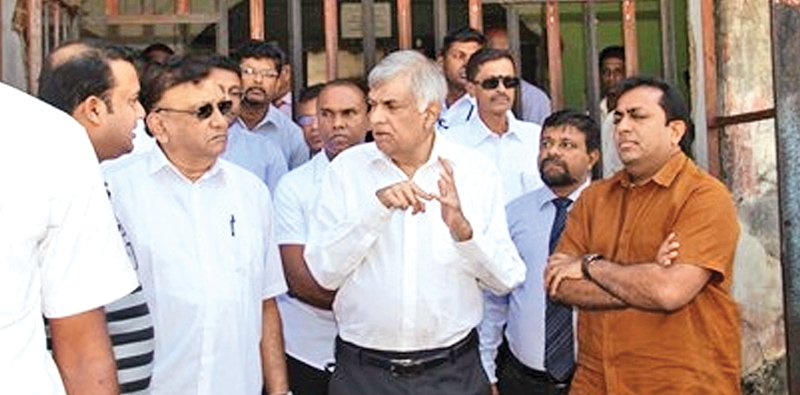 Prime Minister Ranil Wickremesinghe during an inspection tour of the Bogambara Prison yesterday.