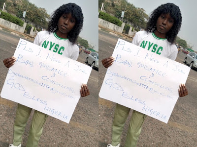 Ex-corp member hits the street with cardboard to beg for job