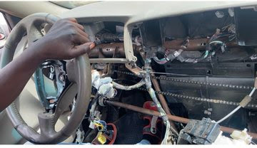 "Near ""n.a.k.e.d"" car used to take driving lessons in Nigeria"