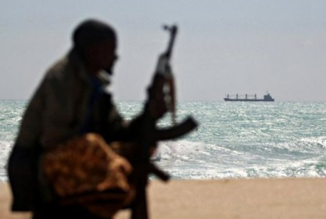 A Somali pirate on lookout in Somalia (file photo: AFP)