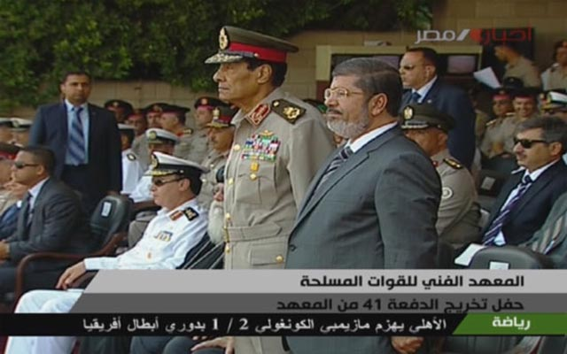 President Mohamed Morsy shared a dais with the two heads of the Supreme Council of Armed Forces at the graduation ceremony for the Military Technical College