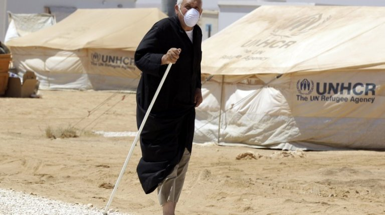 A Syrian refugee walks after undergoing a medical check at a Moroccan military field hospital in the Zaatari camp for Syrian refugees, 15 kilometres (nine miles) from the kingdom's northern city of Mafraq, near the border with Syria, on August 11, 2012. AFP PHOTO/KHALIL MAZRAAWI
