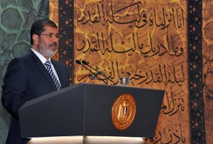 President Mohamed Morsi addresses a religious gathering on 12 August at the Al-Azhar Conference Center in the Cairo suburb of Nasr City -AFP PHOTO / HO / EGYPTIAN PRESIDENCY