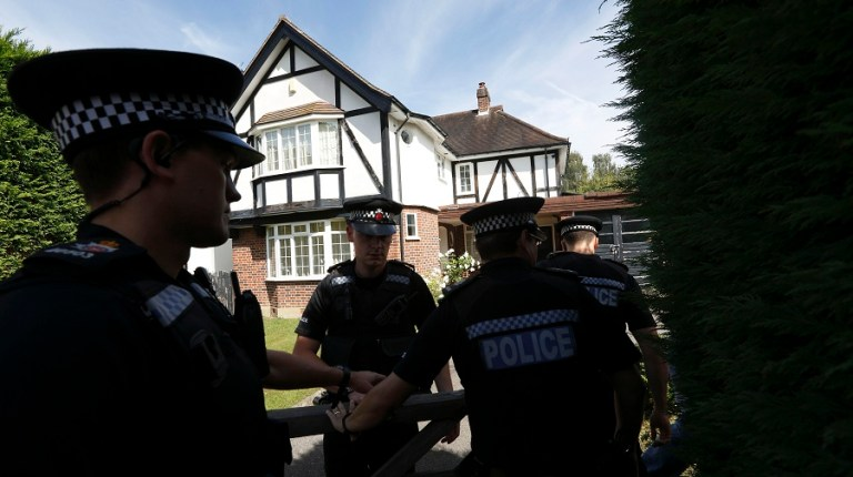 British police officers arrive at a residential address believed to be the British home of the Hilli family shot dead in their car in the French Alps in Claygate, in south-east England AFP PHOTO / JUSTIN TALLIS