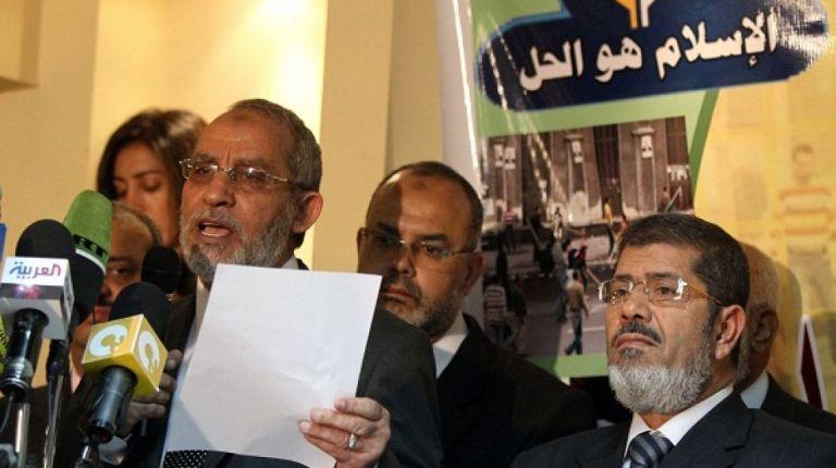 Mohammed Badie, the head of Egypt's Muslim Brotherhood, speaks at a press conference alongside Mohamed Morsy (AFP Photo / Khaled Desouki)