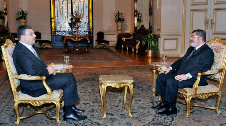 The call for dialogue was announced by Morsi during a two-hour interview with his ex-presidential adviser Amr Al-Leithy, which was aired in the early hours of Monday morning. (Photo Courtesy of the official Facebook Fan Page)