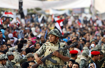 People in three different governorates have adopted the idea of giving signatures to notaries to demand that the army runs the nation. (AFP Photo)