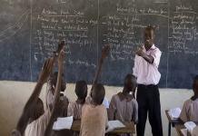 Nigerian teacher with pupils