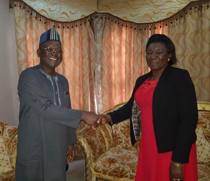 Governor Samuel Ortom congratulating Mrs Veronica Onyeke