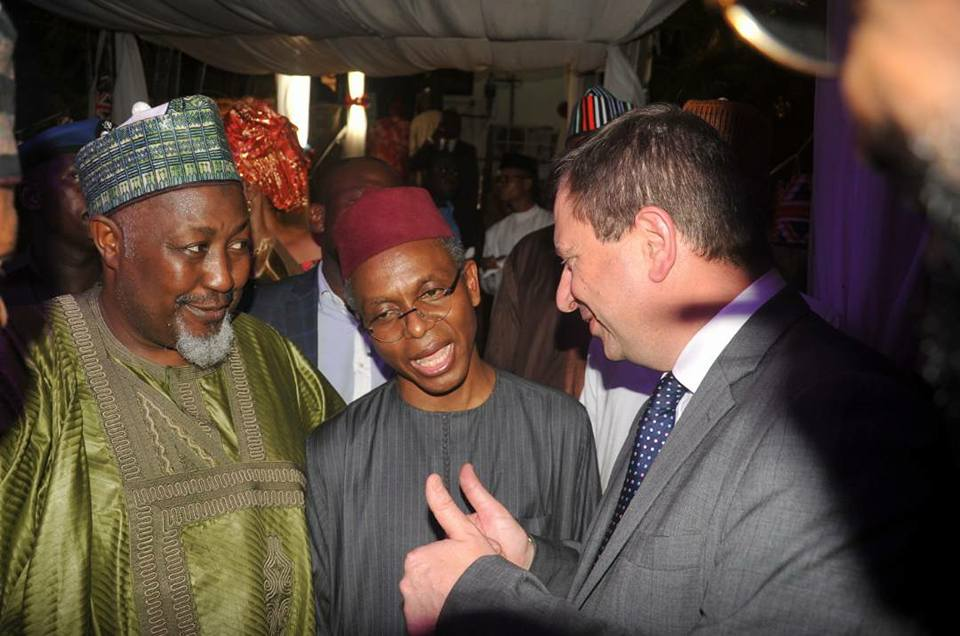 FILE PHOTO: Governor Badaru Abubakar (left) of Jigawa State, his Kaduna State counterpart, Nasir El-Rufai chatting with an unidentified person at a function.