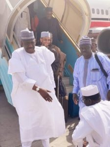 Abdulmumin Jibrin kneels in obeisance before the chairman of Kano APC, Abdullahi Abbas, at Mallam Aminu Kano International Airport, Kano recently