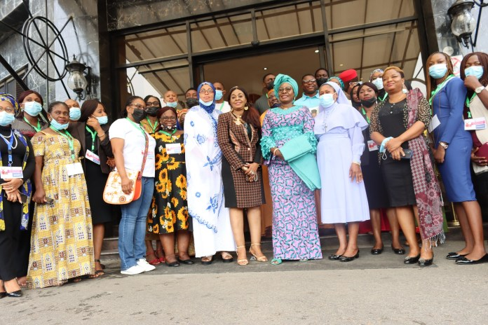 Honorable Minister of Women Affairs, Mrs Pauline Tallen, in a group photograph with participants at the 1-day CSOS engagement with the Ministry to review the national strategy on ending child marriage at the Bolton White Hotel, Abuja on 15th July 2021