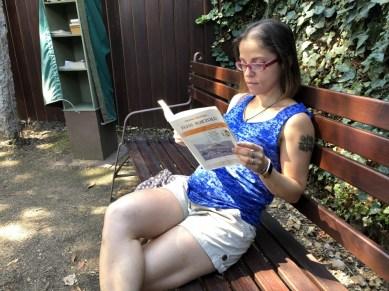 Me reading in Grazia Deledda's internal home courtyard