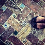 Textures: bricks, stones, and tiles of different sizes and colors on the ground.