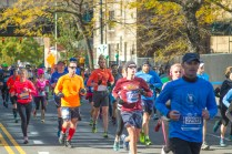 An orange shirt stands out in the crowd during the New York City Marathon.