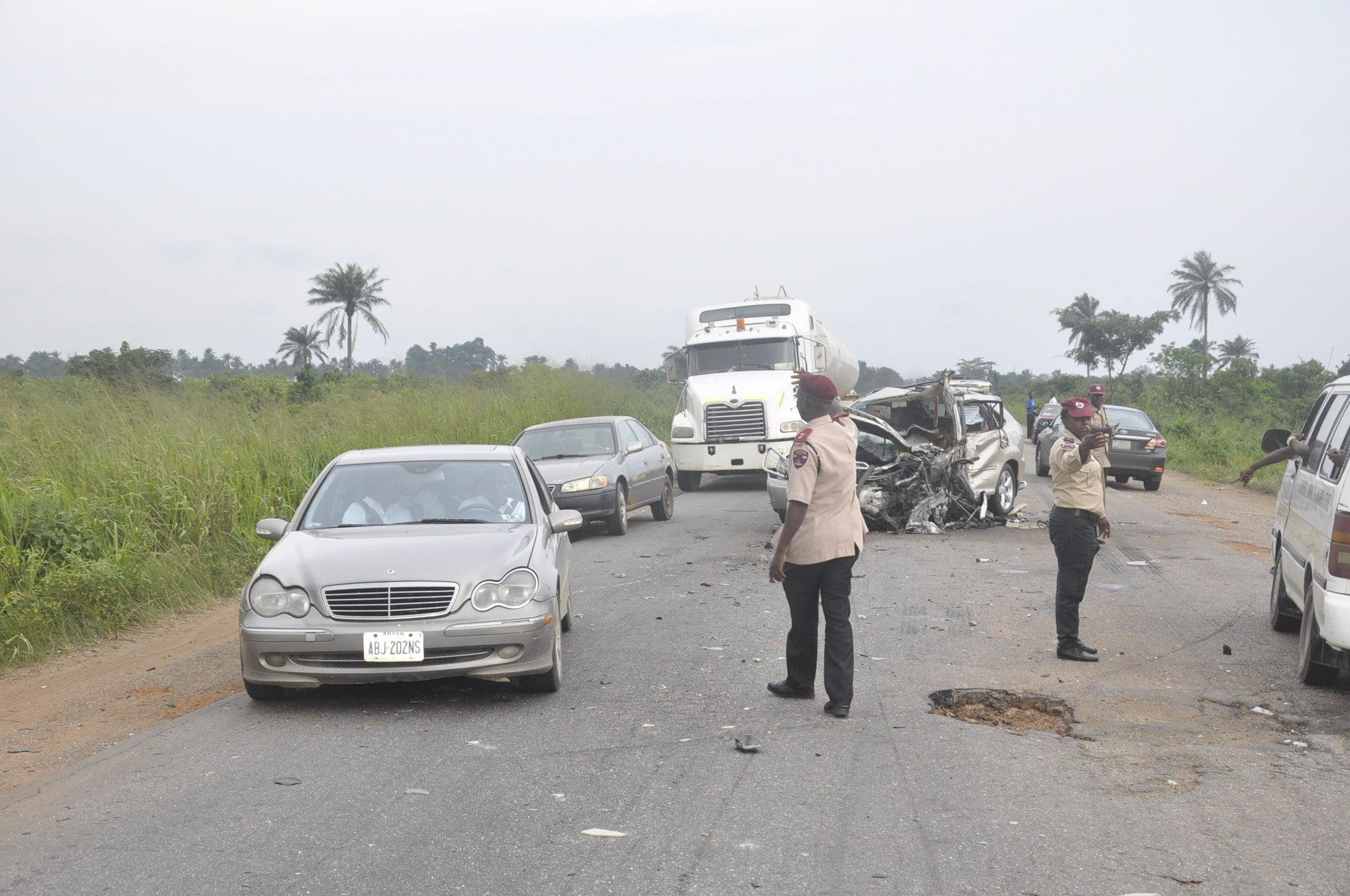 FRSC Officials controling traffic at the accident scene - Kerosine tanker falls on Lagos-Ibadan expressway, injures driver