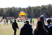 The all-star game commences, with flanked by fans, and bouncehouses in the background at Regent University, Saturday, Nov. 12, 2016. (Nicolas Reynolds)