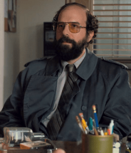 Brett Gelman sits on the set of Stranger Things, playing character Murray Bauman. 2017. (strangerthings.wikia.com)