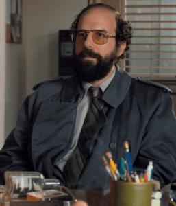 Brett Gelman sits on the set of Stranger Things, playing character Murray Bauman. 2017. (strangerthings.wikia.com)