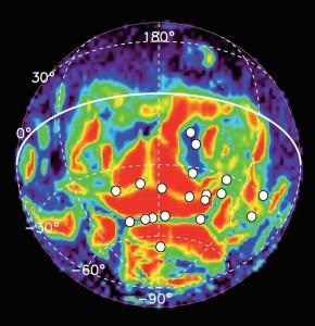 Carte de distribution des aurores discrètes (cercles blancs) recensées par le Pr Gérard dans l'hémisphère sud de Mars. Le paléomagnétisme apparait en fond de carte. © ULg, ESA (Cliquer pour agrandir)