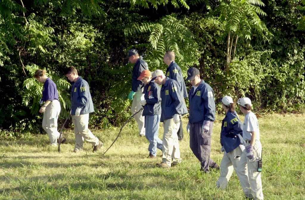 FBI agents search the grounds surrounding the Pentagon on September 12, 2001 in Arlington, Virginia for any evidence related to the attack.(Photo: UPI Photo Service/Michael Kleinfeld/Newscom)