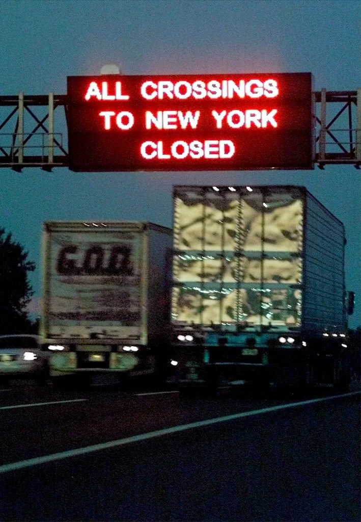 A sign over the New Jersey Turnpike in New Brunswick, New Jersey warns travelers that all bridge and tunnel crossings into New York City have been closed off. (Photo:REUTERS/Jim Bourg/Newscom