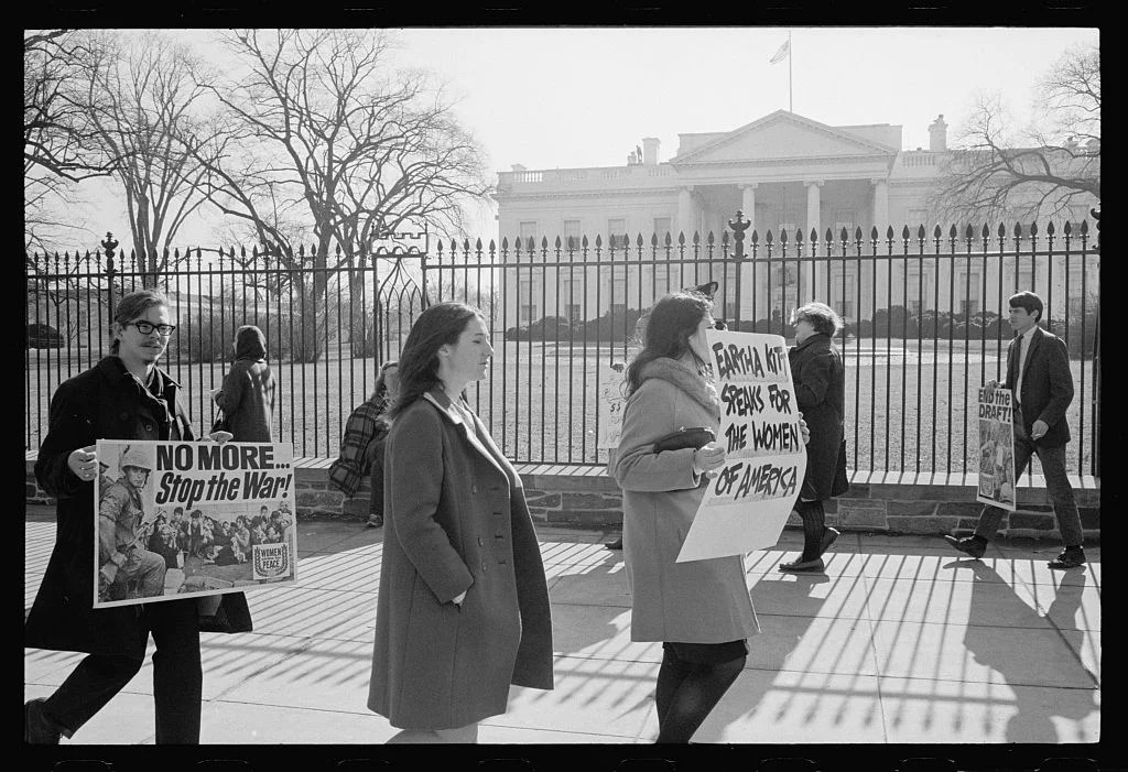 """Anti-war demonstrators carry signs, """"No more...Stop the war!"""" as singer Eartha Kitt speaks for the women of America in front of the White House in 1968. (Photo: Library of Congress)"""