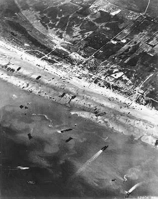 Army Air Corps photographers documented D-Day beach traffic, as photographed from a Ninth Air Force bomber on June 6, 1944. Note vehicle lanes leading away from the landing areas, and landing craft left aground by the tide. (Photo: US Army/Flickr)
