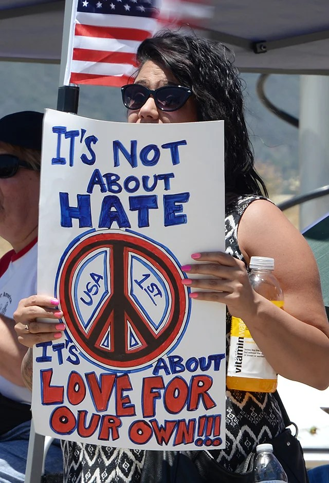 A demonstrator at a protest near the entrance to the US Border Patrol facility in Murrieta, Calif. on July 7, 2014. (Photo: Newscom)