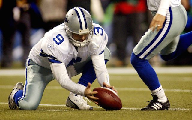 Dallas quarterback Tony Romo (9) mishandles the snap as kicker Martin Gramatica attempts a field against the Seattle Seahawks late in the NFC Wild Card game. The Seahawks defeated the Cowboys, 21-20, at Qwest Field in Seattle, Washington, Saturday, January 6, 2007. (Ron Jenkins/Fort Worth Star-Telegram/MCT)