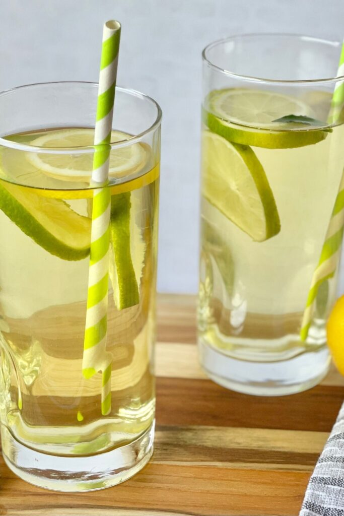 cold brew green tea with lemon and lime slices