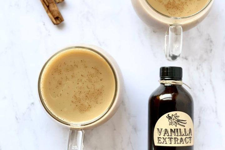 vanilla chai tea with cinnamon sticks and bottle of vanilla