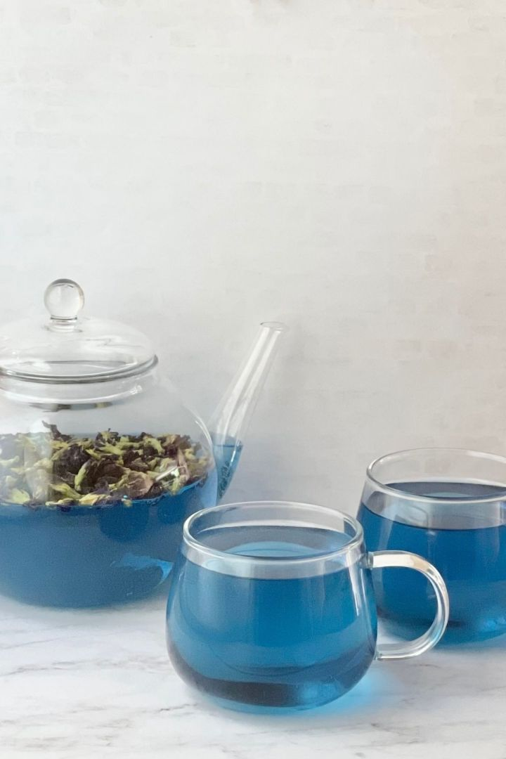 butterfly pea flower tea in tea cups and teapot