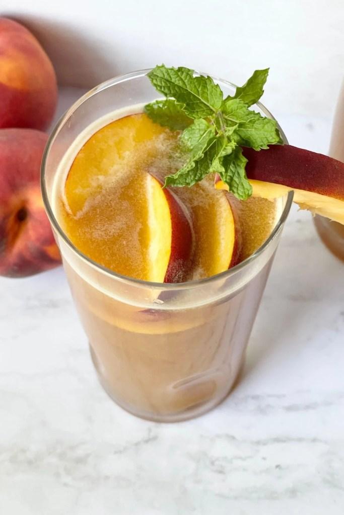 peach iced tea with mint and fresh peaches