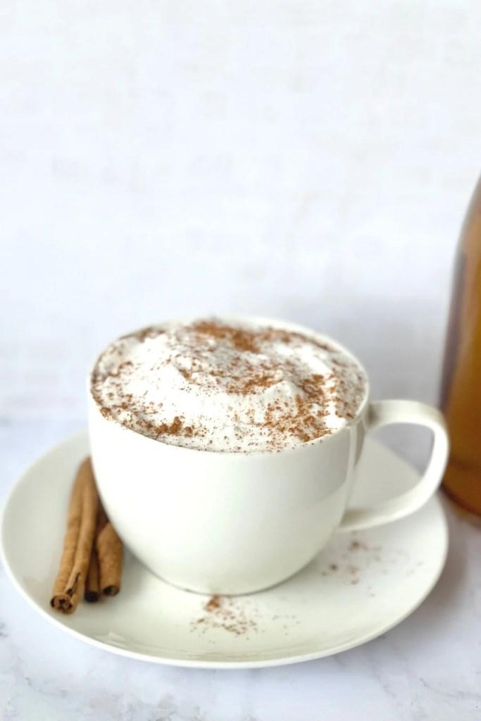 pumpkin spice chai tea latte with cream and cinnamon