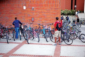 Locked up · Students look for space to secure their bikes at a rack in front of the Lyon Center, to avoid having their bikes impounded by DPS. - Ian Elston | Daily Trojan