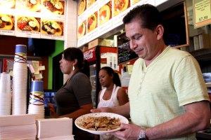 Good service ·  Tito Rivera, who fled a civil war in El Salvador to come to America, serves customers at his restaurant, Viztango Café. - Mike Lee | Daily Trojan