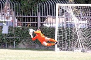 Not so fast · USC senior goalie Kristin Olsen, who became the Women of Troy's career shutout leader, gets airborne on a save against Arizona. - Katelynn Whitaker | Daily Trojan