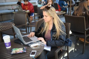 Caught in the Web · Catherine Price, a senior majoring in business administration and political science, uses USC Wireless to access the Web. - William Ehart | Daily Trojan
