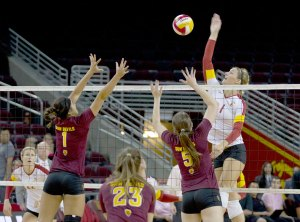 Up and over · Senior middle blocker Alexis Olgard (1) led the Women of Troy in hitting percentage (.394) and blocks (0.95 bps) last season. - Daily Trojan file photo