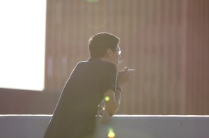 Light 'em up · A USC student takes a break to smoke a cigarette across from Waite Phillips Hall on campus. USC researchers received a grant from the Food and Drug Administration to research the effects of smoking. tobacco. - Photo Illustration by Nick Entin