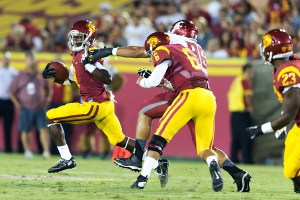 Break away · USC junior wide receiver Marqise Lee's return on Saturday provided a huge boost to the Trojans' offense. Lee led the USC attack with five receptions for 105 yards and one receiving touchdown. - Ralf Cheung | Daily Trojan