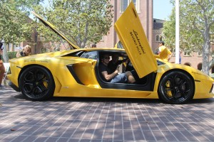 Vroom vroom · Aaron Bajor (front), president of the USC Auto Club, and Ryan McLean (back), secretary of the USC Auto Club, strike a pose in a Lamborghini, one of the cars on display during Sunday's event. - Paul Jung   Daily Trojan